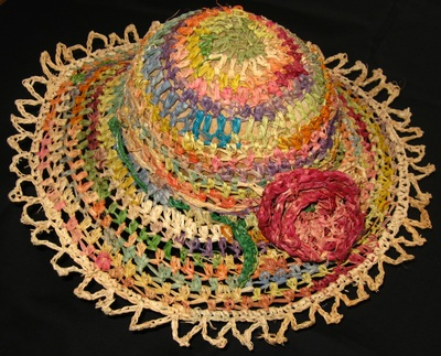 Multicolor raffia sun hat with crocheted rose and laced edging, crocheted by C. Buffalo Larkin