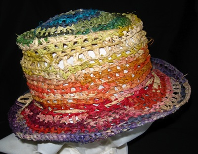 Out of Africa Hat (rainbow colors), crocheted raffia by C. Buffalo Larkin