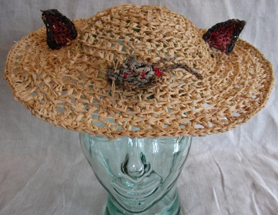 Cat Shepherdess Hat with Dead Mouse, crocheted raffia by C. Buffalo Larkin