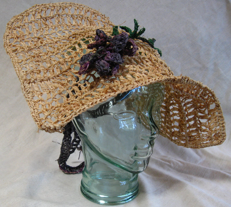 Shepherdess Hat with Wisteria, crocheted raffia by C. Buffalo Larkin