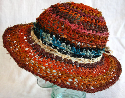 Earthtone Lady Di Hat, crocheted raffia by C. Buffalo Larkin