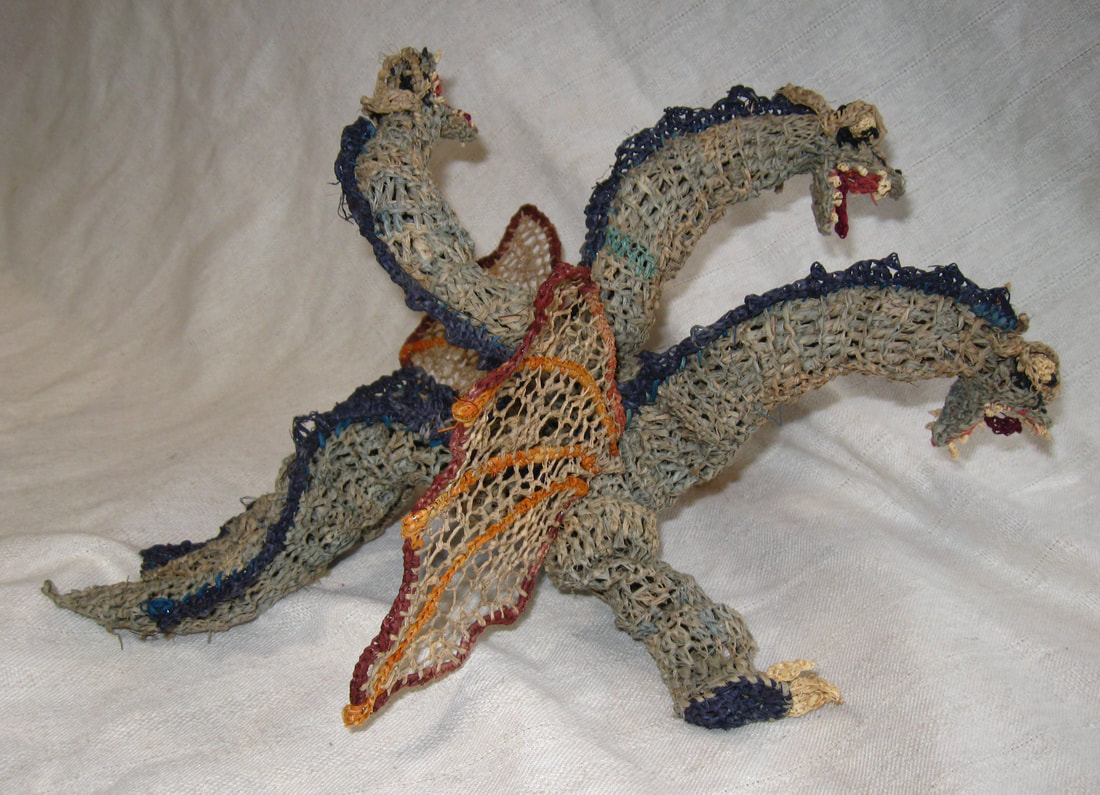 Ghidorah rendered in raffia, image 1