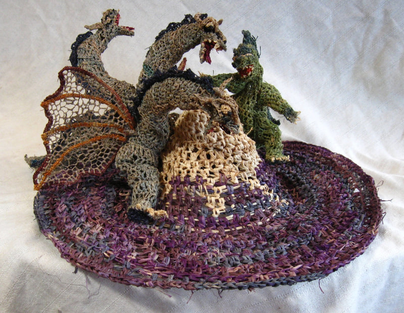 Godzilla v. Ghidorah on Mt. Fuji Hat, crocheted raffia by C. Buffalo Larkin